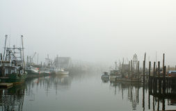 Harbor in fog Royalty Free Stock Photography