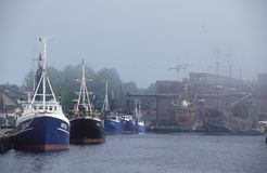 Harbor in a fog Royalty Free Stock Photo