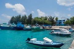 Harbor full of fishermen`s and cargo boats located at the Villingili tropical island stock photos