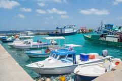 Harbor full of fishermen`s and cargo boats at the Villingili tropical island Royalty Free Stock Image