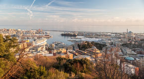 The harbor of Genoa seen from surrounding hills during the golden hour Stock Image
