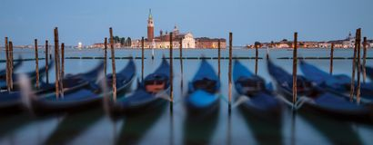 Harbor with gondolas in venice at night royalty free stock photo