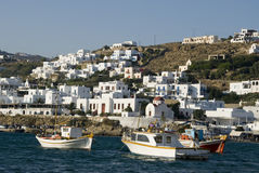Harbor in the greek islands. Greek island harbor with fishing boats and classic cyclades arcthitecture stock photos