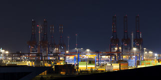 Harbor of Hamburg with cranes and containers at night Stock Photography