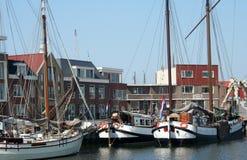 The harbor of Harlingen. Netherlands, Harlingen,-june 2016: Ships moored in the port Stock Photos