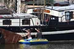 The harbor of Harlingen. Netherlands, Harlingen,-june 2016: Work on the brown fleet Royalty Free Stock Images