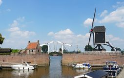 Harbor in Heusden, the Netherlands. Heusden, the Netherlands. June 2019. Various boats in the harbor of Heusden, a historical and fortified village in the stock images