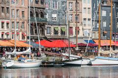 Harbor historic city Honfleur with moored sailing ships and restaurants Stock Photo