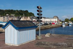 Harbor Honfleur with wooden storehouse and nautical traffic lights, France Royalty Free Stock Photo