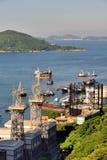 A harbor of Hongkong city, 2016. Island and sea around Hongkong city, shown as people life and environement in Hongkong, and harbor or industry Stock Photos