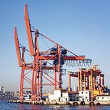 Harbor with industrial cranes. Commercial harbor with large industrial cranes Stock Images