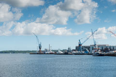 Harbor of Kiel in germany. With submarine ships and industrial cranes Stock Photo