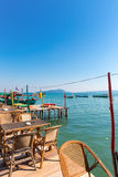 Harbor of Koh Rong with empty table and chairs on the Pier.  Stock Photography