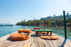 Harbor of Koh Rong with empty table and chairs on the Pier. Camb Royalty Free Stock Images