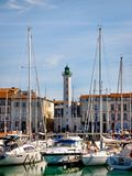 Harbor of La Rochelle on the Bay of Biscay, France. LA ROCHELLE, FRANCE - MARCH 29, 2017: Boats and yachts at the Harbor of La Rochelle, the French city and royalty free stock image
