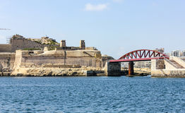 Harbor in La Valetta, Malta. Ancient harbor in La Valetta, Malta under blue sky Stock Photo