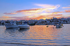 Harbor from Lagos in Portugal at sunset Stock Photos