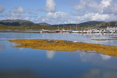 Harbor on the lake over the mountains Royalty Free Stock Photography