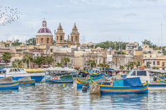 Harbor of Marsaxlokk, a fishing village in Malta. Harbor of Marsaxlokk, a traditional fishing village located in the south-eastern part of Malta Stock Photography