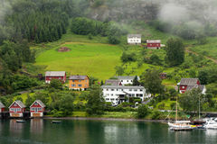 Harbor an medow in flam fjord Stock Image