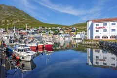 The harbor with moored fishers boats in Honningsvag town in Mageroya island.  Nordkapp Municipality in Finnmark county