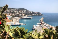 Harbor with boats in Nice, France. The harbor of Nice in France with some boats, seen from above from behind the cactus trees Stock Photography