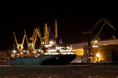 Harbor in the night. Harbor in the winter night with ship and cranes royalty free stock image