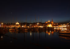 Harbor at night. Some sailing ships in a harbor at night. In the background you see the city Flensburg stock photography