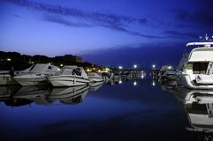 Harbor at night in Italy Stock Photo