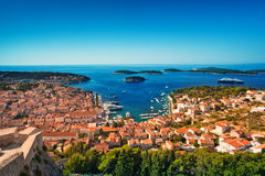 Harbor of old Adriatic island town Hvar. High angle panoramic view. Popular touristic destination of Croatia Stock Photos