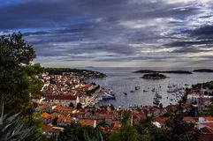 Harbor of old Adriatic island town Hvar at the sunset Stock Images