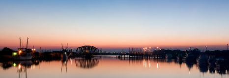Harbor Panorama at Dawn. Panorama of a small harbor in Freeport, Texas.  Chemical plants and refineries are in the background Royalty Free Stock Photo