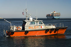 Harbor Pilot Boat and Container Ship Royalty Free Stock Photography