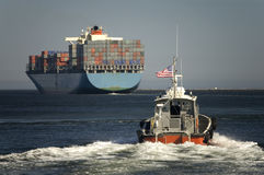 Harbor Pilot Boat and Container Ship Stock Images
