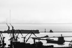Harbor and port with cranes and ships, industrial background Stock Photos