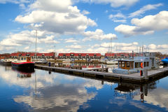 Harbor at Reitdiephaven with sky reflected in water Stock Image