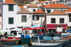 Harbor with restaurants and fishing ships at Madeira Stock Images