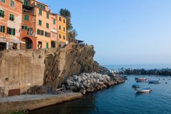 Harbor in Riomaggiore. Little harbor with boat at sunset in Riomaggiore - Cinque Terre - Italy Royalty Free Stock Images