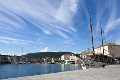 Harbor with sailing ship Stock Photo