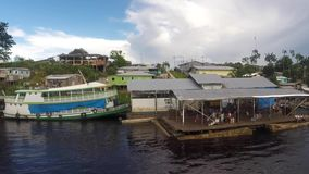 Harbor of Santo Antonio Do Ica on the Amazon River in Brazil stock footage