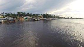 Harbor of Santo Antonio Do Ica on the Amazon River in Brazil. Village and the harbor of Santo Antonio Do Ica with blue sky, on the Amazon River. Brazil 2015 stock video footage