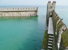Harbor of the Scaliger Castle at the lago di Garda Stock Photos
