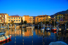 Harbor scene at Lake Iseo. Panoramic view of sunset on city Iseo, Italy royalty free stock photo
