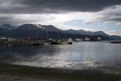 Harbor scene with stormy sky stock image
