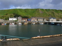 Harbor in Scotland. A row of buildings on the harbor in Scotland Royalty Free Stock Images