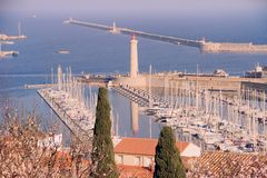 Harbor of Sete, Languedoc-Roussillon, France. View on the harbor of Sete with  Lighthouse of the Saint-Louis mole, Sete, Languedoc-Roussillon, France stock photos