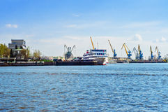 Harbor with ship and cranes. Harbor with passenger ship and portal gantry cranes. Summer day stock photos