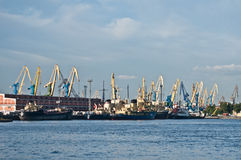 Harbor with ships and cranes Stock Images