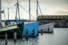 Harbor and ships. In the fall with grey sky Royalty Free Stock Photos