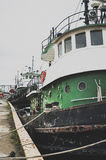 Harbor side. Large tug boats tie up in a harbor on Lake Michigan Stock Photography